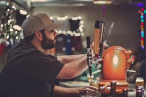 Brewtender Alex pouring a pint at Crux Fermentation Project in Bend, Oregon