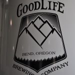 Good Life Brewing logo on the side of a fermentation tank.