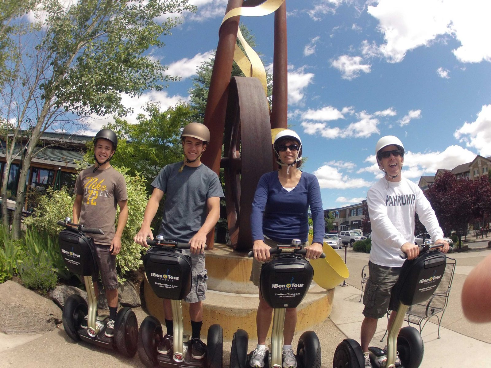 A family posing in the plaza of the Old Mill on our on of our SEGWAY Sightseeing Tours