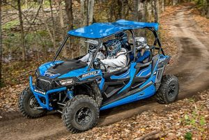 Off-Road tours - ATV sightseeing guests speed down a trail