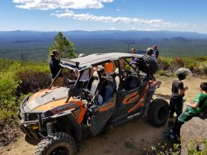 ATV tours parked on a stunning vista.