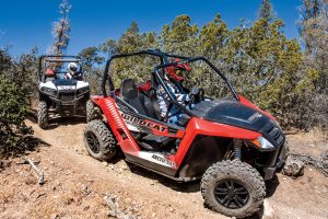Off-Road tours - ATV sightseeing guests speed down a trail.