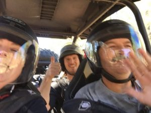 A helmeted group enjoying one of BTC's ATV tours
